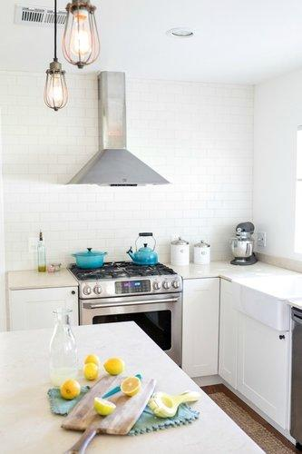 A dark and dated kitchen gets a budget friendly transformation for Ikea kitchen cabinets assemble yourself