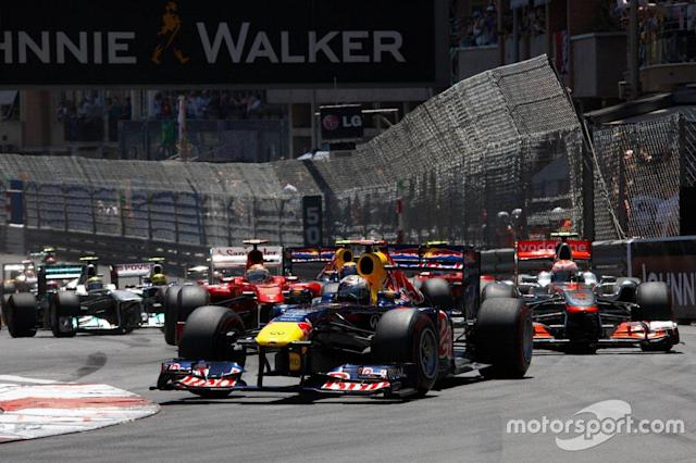 "Sebastian Vettel, Red Bull RB7 Renault leads at the start <span class=""copyright"">Rainer W. Schlegelmilch</span>"