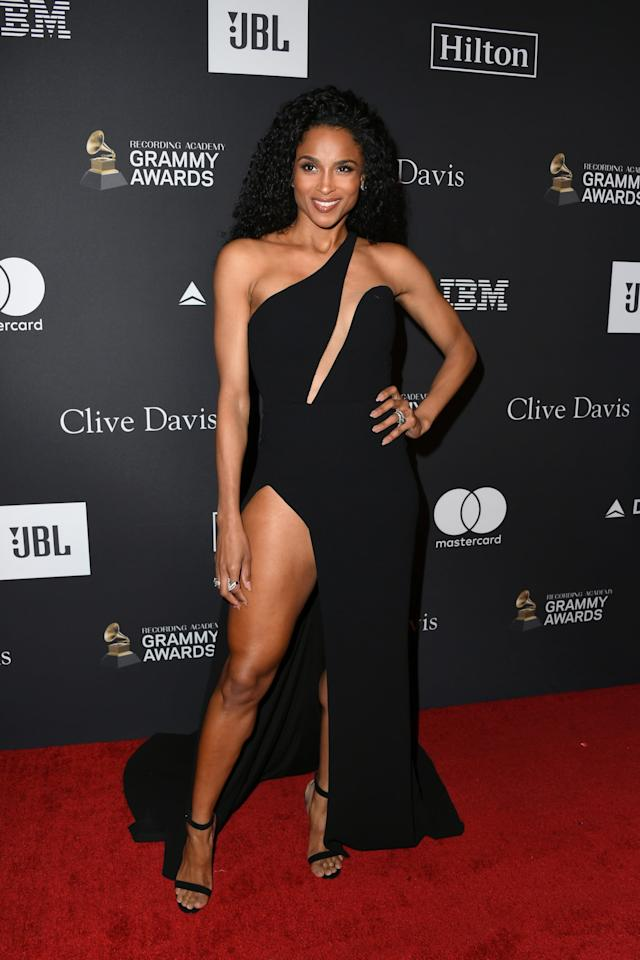 <p>Ciara arrived at Clive Davis's annual pre-Grammy party in a black one-shoulder gown from Romona Keveža, which featured an eye-catching asymmetrical bodice and, as usual, a sky-high side slit. </p>