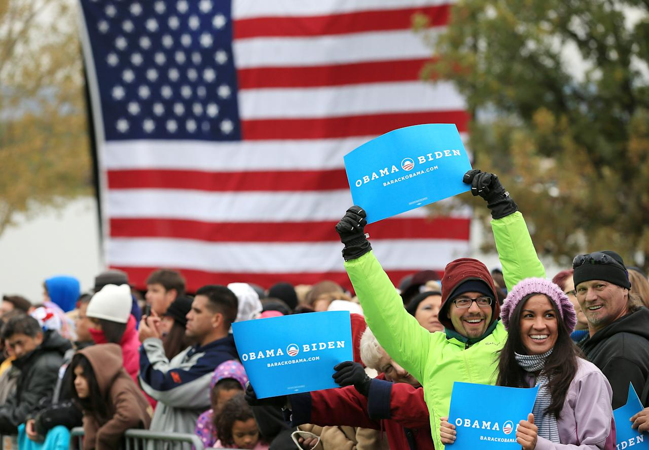 DENVER, CO - OCTOBER 04:  Supporters wait for U.S. President Barack Obama to speak during a campaign rally at Sloan's Lake Park on October 4, 2012 in Denver, Colorado. Obama spoke the morning after the first Presidential debate at the University of Denver.  (Photo by Doug Pensinger/Getty Images)