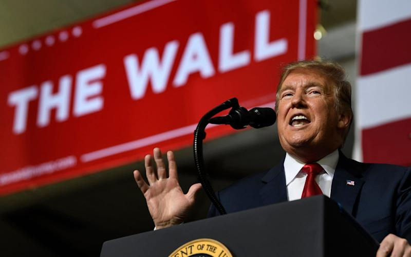 President Donald Trump speaks during a rally in El Paso, Texas, Monday, Feb. 11, 2019 - AP