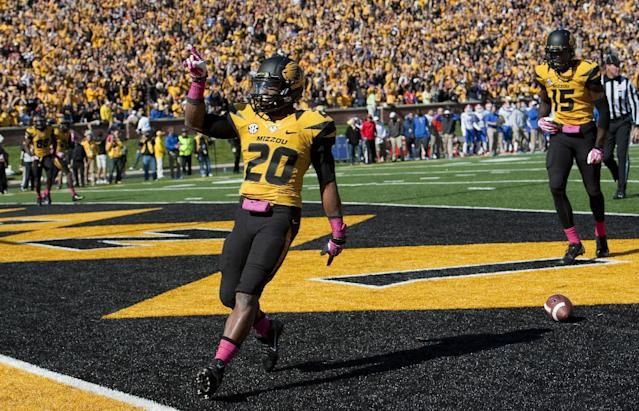 Missouri running back Henry Josey, left, celebrates in front of teammates Dorial Green-Beckham, right, after he scored on a 6-yard run in the third quarter of an NCAA college football game against Florida Saturday, Oct. 19, 2013, in Columbia, Mo. (AP Photo/L.G. Patterson)