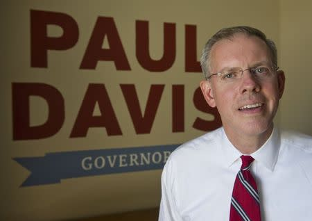 Democratic Governor candidate Paul Davis poses for a photographer at his headquarters in Lawrence, Kansas