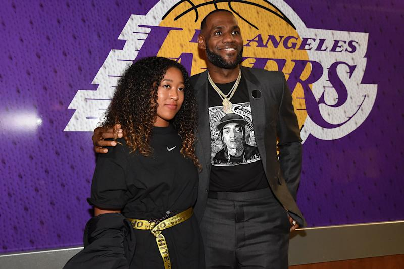 LOS ANGELES, CA - APRIL 4: Tennis Player, Naomi Osaka poses for a photo with LeBron James #23 of the Los Angeles Lakers after the game on April 4, 2019 at STAPLES Center in Los Angeles, California. NOTE TO USER: User expressly acknowledges and agrees that, by downloading and/or using this Photograph, user is consenting to the terms and conditions of the Getty Images License Agreement. Mandatory Copyright Notice: Copyright 2019 NBAE (Photo by Andrew D. Bernstein/NBAE via Getty Images)