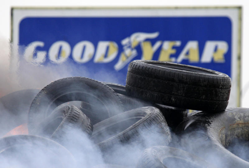 Goodyear employees burn tires, outside the Goodyear tire company, in Amiens, northern France, Tuesday Feb. 26, 2013. Workers at a dying French tire factory who've become the butt of American jokes are staging a day of last-ditch protests to try to save their jobs. The protests in the northern city of Amiens come after efforts to find a new buyer for the struggling plant have fizzled. An American executive who considered buying it sent a letter last week to the French government saying that France's economic model is too worker-friendly and discourages investment. (AP Photo/Michel Spingler)
