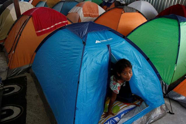 A Central American child migrant, moving in a caravan through Mexico and traveling to request asylum in the U.S., is seen inside a tent at the Juventus 2000 shelter after arriving to Tijuana, Mexico April 24, 2018. REUTERS/Jorge Duenes
