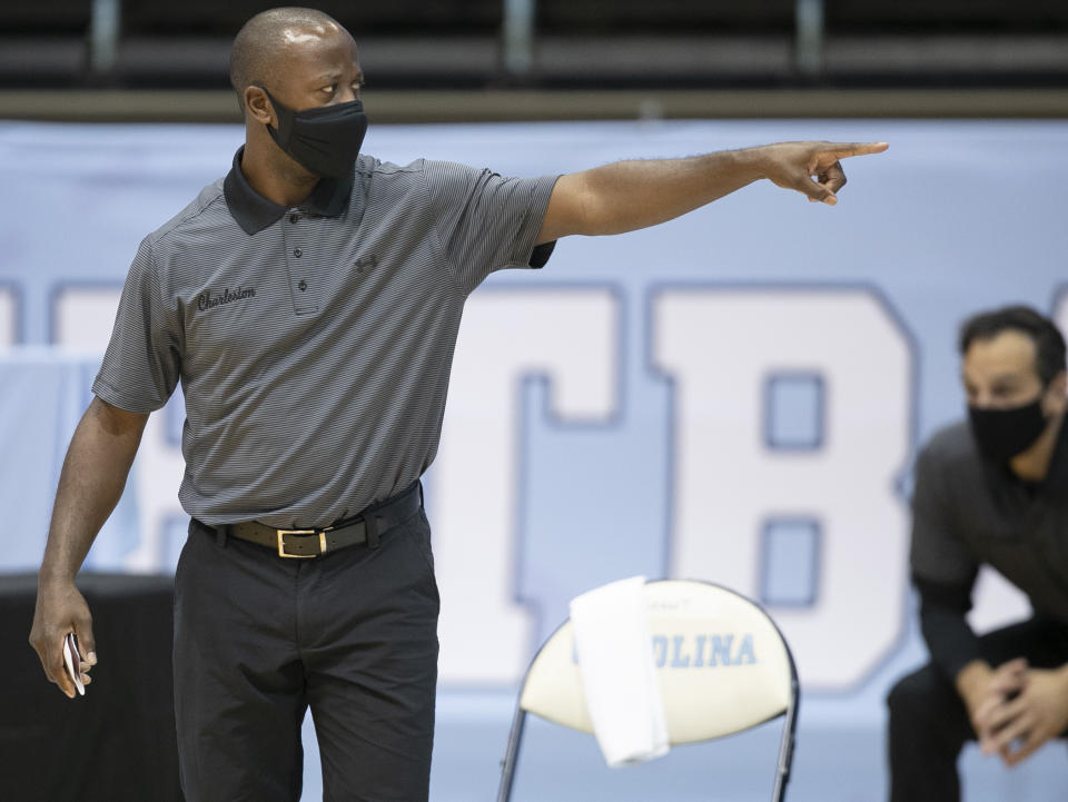 College of Charleston coach Earl Grant directs his team during the first half of an NCAA college basketball game against North Carolina on Wednesday, Nov. 25, 2020, in Chapel Hill, N.C. (Robert Willett/The News & Observer via AP, Pool)