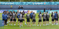 Denmark's manager Kasper Hjulmand, center, talks to his team at the training ground during a training session of Denmark's national team in Helsingor, Denmark, Monday, June 14, 2021. It is the first training of the Danish team since the Euro championship soccer match against Finland when Christian Eriksen collapsed last Saturday. (AP Photo/Martin Meissner)