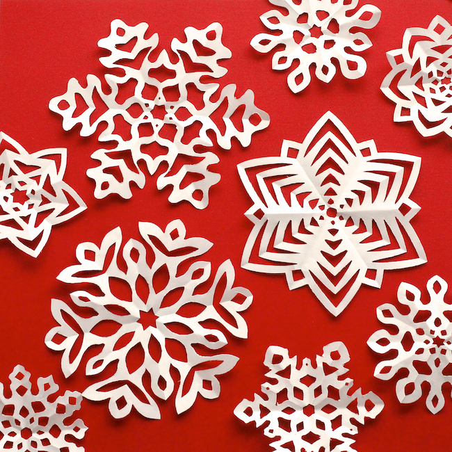 """<p>You can make your paper snowflakes one-of-a-kind by using this blogger's templates and then adding a few of your own unique cuts before unfolding. Hang them by a window, attach them to cards, or display them just about anywhere.</p><p><strong>Get the tutorial at <a href=""""http://www.omiyageblogs.ca/2013/12/cut-fold-kirigami-snowflakes.html"""" rel=""""nofollow noopener"""" target=""""_blank"""" data-ylk=""""slk:Omiyage Blogs"""" class=""""link rapid-noclick-resp"""">Omiyage Blogs</a>.</strong></p><p><strong><a class=""""link rapid-noclick-resp"""" href=""""https://www.amazon.com/Sheets-Origami-Folding-Paper-6-inch/dp/B0034JIOMK/?tag=syn-yahoo-20&ascsubtag=%5Bartid%7C10050.g.23489557%5Bsrc%7Cyahoo-us"""" rel=""""nofollow noopener"""" target=""""_blank"""" data-ylk=""""slk:SHOP ORIGAMI PAPER"""">SHOP ORIGAMI PAPER</a><br></strong></p>"""
