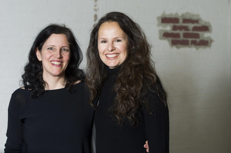 """This April 16, 2014 photo shows Laura Poitras, left, and Johanna Hamilton in New York to promote their documentary film """"1971,"""" premiering Friday at the Tribeca Film Festival. (Photo by Charles Sykes/Invision/AP)"""