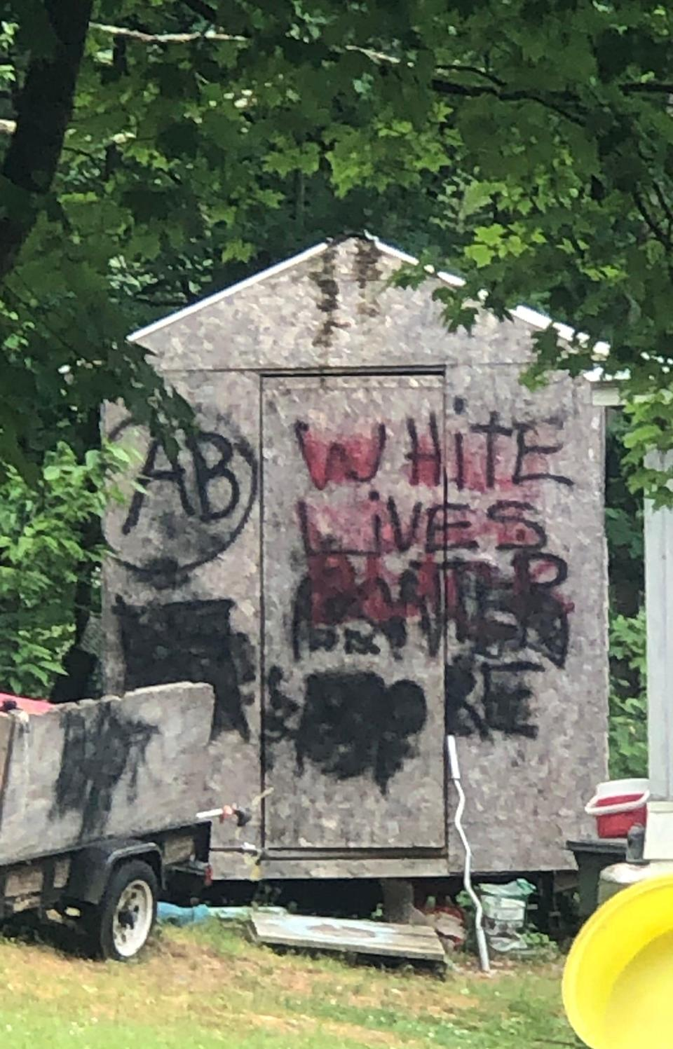 """""""White Lives Matter More"""" and AB (Aryan Brotherhood) painting at neighbor's home in southern Vermont."""