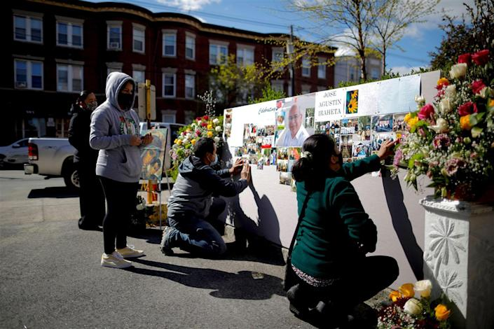 Parishioners prepare a memorial for Jose Agustin Iraheta, who died from Covid-19, before funeral blessings at Saint Rose of Lima Catholic Church in Chelsea, Mass., on May 12.