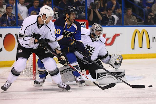 ST. LOUIS, MO - APRIL 30: Jake Muzzin #6 and Jonathan Quick #32 both of the Los Angeles Kings defend the net against Andy McDonald #10 of the St. Louis Blues in Game One of the Western Conference Quarterfinals during the 2013 NHL Stanley Cup Playoffs at the Scottrade Center on April 30, 2013 in St. Louis, Missouri. (Photo by Dilip Vishwanat/Getty Images)