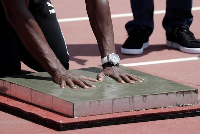 Usain Bolt visits the remodeled Atletico de la VIDENA Stadium and places his handprints in cement in Lima, Peru April 3, 2019. REUTERS/Henry Romero