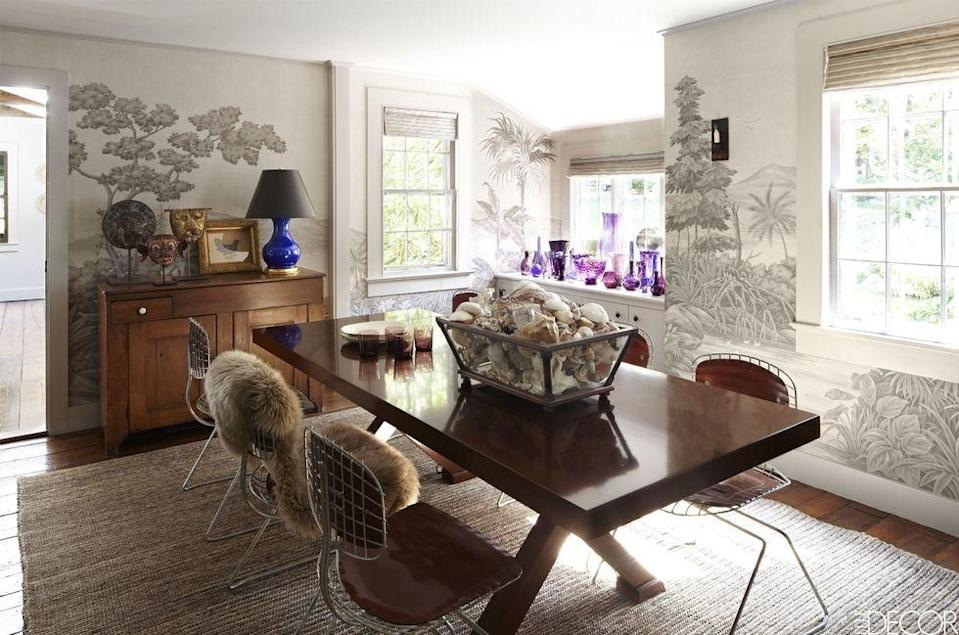 """<p>The dining room of a <a href=""""https://www.elledecor.com/design-decorate/house-interiors/a8344/connecticut-country-home/"""" rel=""""nofollow noopener"""" target=""""_blank"""" data-ylk=""""slk:classic Connecticut home"""" class=""""link rapid-noclick-resp"""">classic Connecticut home</a> features chairs designed by Richard Rogers and Renzo Piano, a custom-made table, and an 18th-century pine commode from Vermont. The landscape-inspired, hand-painted wall covering is by Gracie, and the rug is by Holland & Sherry.<br><br><em>Advantage Trees Wallpaper, $13.43<br></em><a class=""""link rapid-noclick-resp"""" href=""""https://www.mahoneswallpapershop.com/product/2773-605419-neutral-black-white-blacks-trees-wallpaper-advantage?gclid=CjwKCAjw8NfrBRA7EiwAfiVJpYqjIJTqcsgldBI-d5fbkmQhuujxdMn2iHQm-KKPOyTFRVrc_2lRhRoCJpsQAvD_BwE"""" rel=""""nofollow noopener"""" target=""""_blank"""" data-ylk=""""slk:Shop the Look"""">Shop the Look</a></p>"""