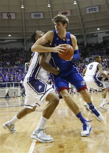 TCU forward Adrick McKinney, left, defends as Kansas center Jeff Withey, right, looks to move to the basket during the first half of an NCAA college basketball game Wednesday, Feb. 6, 2013, in Fort Worth, Texas. (AP Photo/Sharon Ellman)