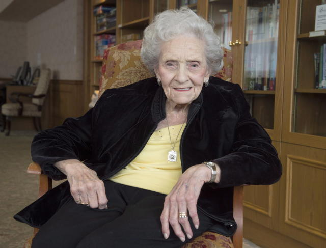 """In this March 2, 2017, photo, Kay MacBeth poses during an interview in Toronto. They were basketball's version of """"A League of Their Own,"""" a group of trailblazing women who dominated Canadian basketball for a quarter century. Kay MacBeth, the last surviving member of the Edmonton Graduates, died Saturday, July 21, 2018. She was 96. (Frank Gunn/The Canadian Press via AP)"""