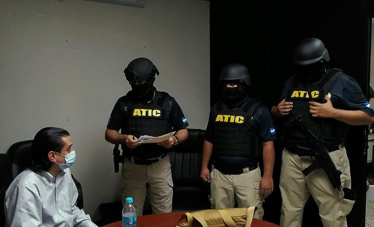 Forces from Honduras' Technical Criminal Investigation Agency detain Marco Antonio Bogran, the former director of Strategic Investments of Honduras, in April 2021 over allegations of irregular purchases of mobile hospitals