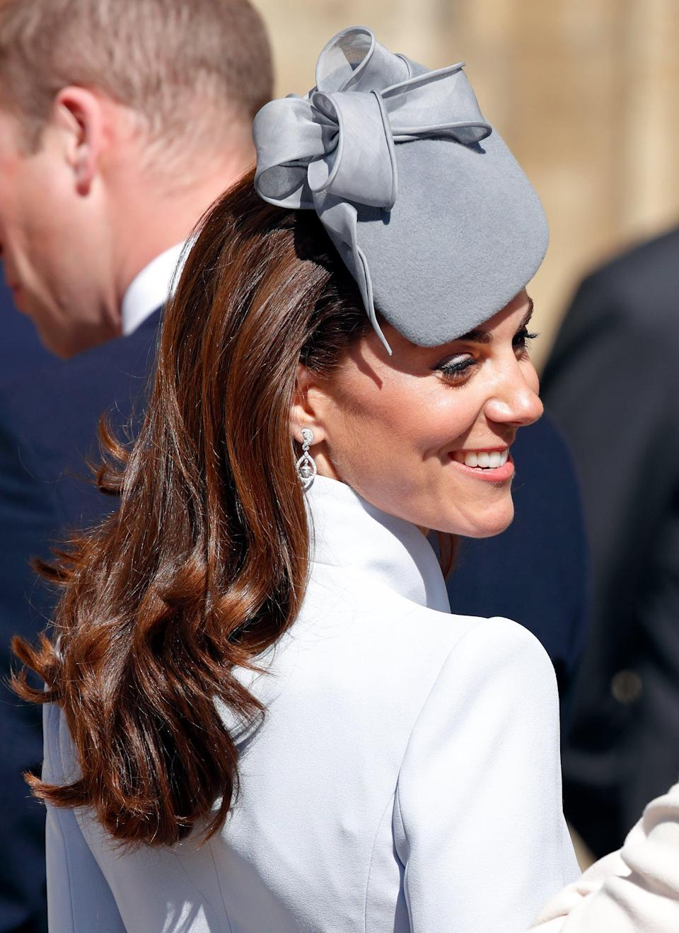 <p>For Easter Service this year, Middleton let her hair down and wore it brushed away from her face with dropped curls.</p>
