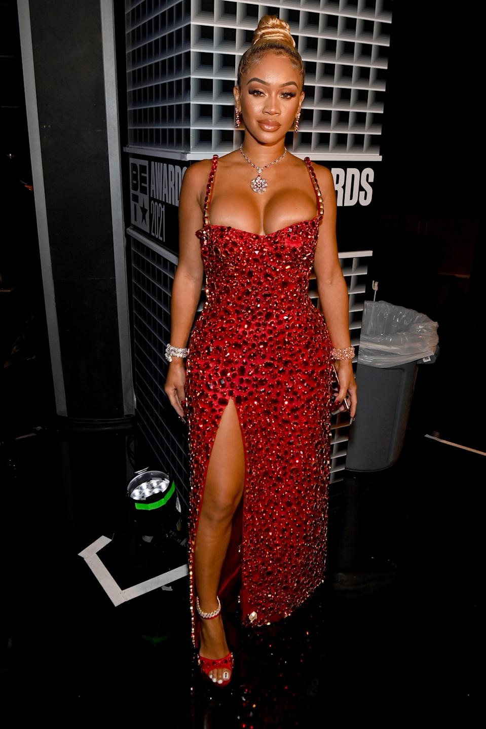 """The """"My Type"""" rapper turned heads in her second outfit of the night – this red embellished stunner. Yes, she complained that it was """"heavy AF"""" but she looked stunning so we'd say it was worth it."""