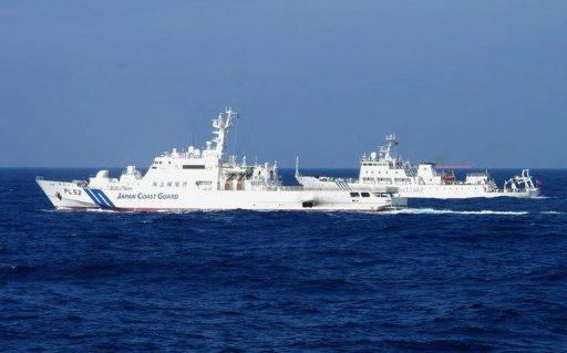 <p>A Chinese marine surveillance ship (R) is shown alongside a Japan Coast Guard ship near the disputed islets known as the Senkaku islands in Japan and Diaoyu islands in China, in the East China Sea, February 4, 2013. Tensions between Tokyo and Beijing are simmering due to a row over the sovereignty of a series of uninhabited, but strategically vital, islands.</p>