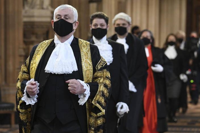 Speaker of The House of Commons Sir Lindsay Hoyle walks through the Central Lobby on the way to the House of Lords prior to Queen Elizabeth II delivering a speech during the State Opening of Parliament in the House of Lords at the Palace of Westminster in London, Tuesday May 11, 2021. (Stefan Rousseau/Pool via AP)