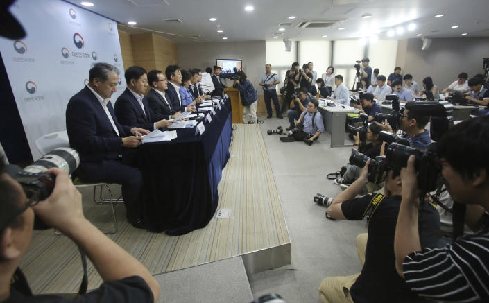 Sung Yun-mo, fourth from left, South Korea's minister of Trade, Industry and Energy, speaks during a press conference at the government complex in Seoul, South Korea, Monday, Aug. 5, 2019. Sung said South Korea will spend 7.8 trillion won ($6.5 billion) over the next seven years to develop technologies for industrial materials and parts as it moves to reduce its dependence on Japan during an escalating trade row. The announcement came days after Japan's Cabinet approved the removal of South Korea from a list of countries with preferential trade status. (AP Photo/Ahn Young-joon)