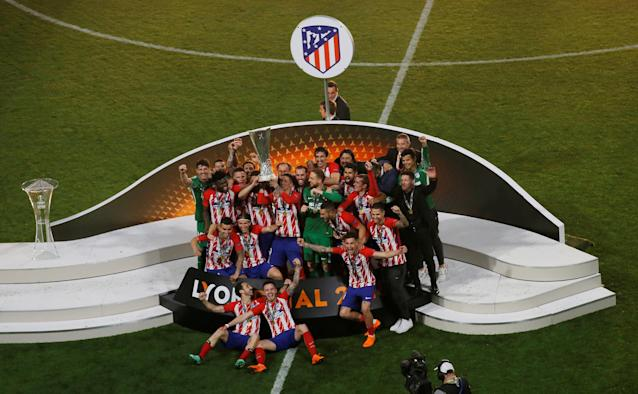 Soccer Football - Europa League Final - Olympique de Marseille vs Atletico Madrid - Groupama Stadium, Lyon, France - May 16, 2018 Atletico Madrid celebrate with the trophy after winning the Europa League REUTERS/Vincent Kessler