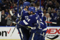Tampa Bay Lightning defenseman Jan Rutta (44) celebrates with defenseman Victor Hedman (77) after Rutta scored against the New York Islanders during the third period in Game 2 of an NHL hockey Stanley Cup semifinal playoff series Tuesday, June 15, 2021, in Tampa, Fla. (AP Photo/Chris O'Meara)