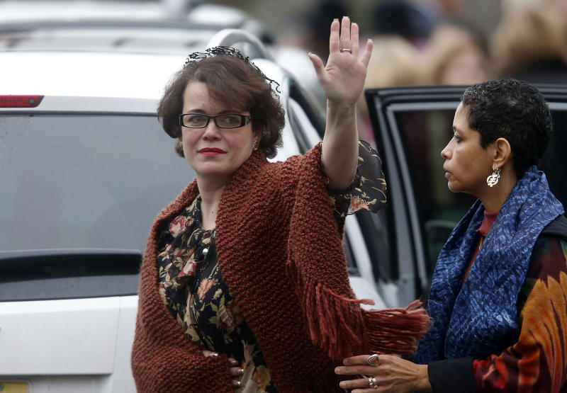 FILE - In this Dec. 17, 2012 file photo, Veronique Pozner waves to the assembled media as she leaves after a funeral service for her 6-year-old son Noah Pozner, in Fairfield, Conn. Noah Pozner was killed in the shooting at Sandy Hook Elementary School in Newtown, Conn., on Dec. 14.  Veronique Pozner, said Thursday, Jan. 10, 2013, that she wondered why she hadn't received more information about legislative proposals regarding guns in the weeks after the shooting.  (AP Photo/Jason DeCrow, File)