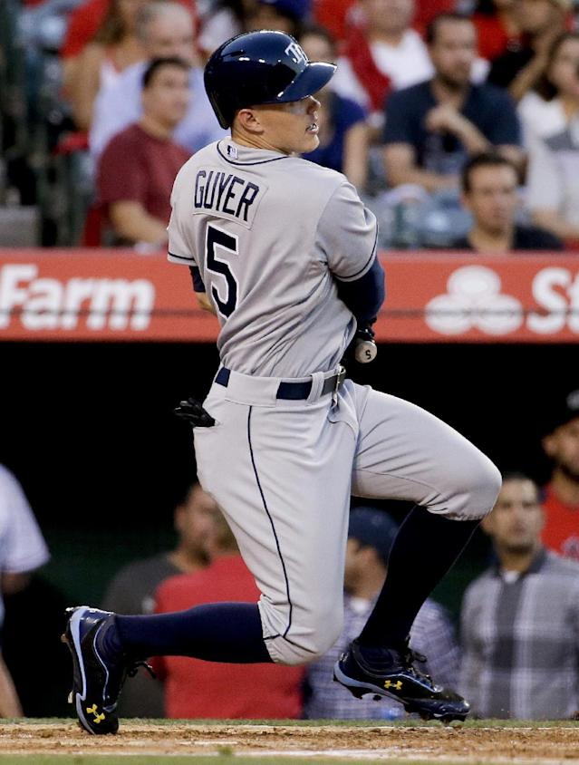 Tampa Bay Rays' Brandon Guyer watches his RBI single against the Los Angeles Angels during the second inning of a baseball game in Anaheim, Calif., Thursday, May 15, 2014. (AP Photo/Chris Carlson)