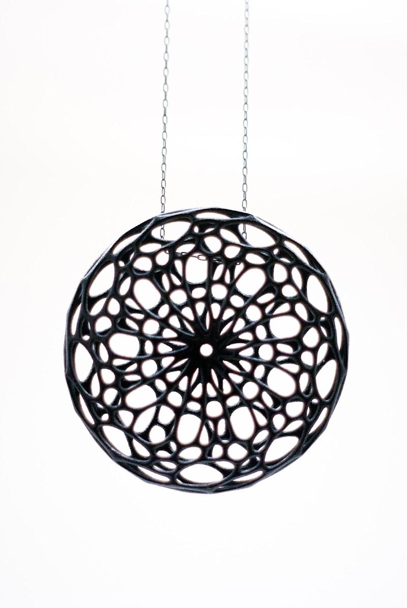 This undated publicity photo provided by Nervous System shows a black nylon plastic Cellular Pendant, created by designer Jessica Rosenkrantz. This and other pieces were inspired by cell-like structures found in nature. The design studio, Nervous System, in Somerville, Mass., prints art, jewelry and housewares in sterling silver, stainless steel and nylon plastic using 3D printer technology.  (AP Photo/Nervous System, Jessica Rosenkrantz)