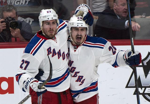 New York Rangers' Chris Kreider, right, celebrates his goal against the Montreal Canadiens with teammate Ryan McDonagh during the second period of Game 5 of the NHL hockey Stanley Cup playoffs Eastern Conference finals, Tuesday, May 27, 2014, in Montreal. (AP Photo/The Canadian Press, Paul Chiasson)