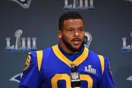 FILE PHOTO: Jan 31, 2019; Atlanta, GA, USA; Los Angeles Rams defensive end Aaron Donald (99) answers questions from the media during press interviews at Marriott Atlanta Buckhead. Mandatory Credit: Dale Zanine-USA TODAY Sports