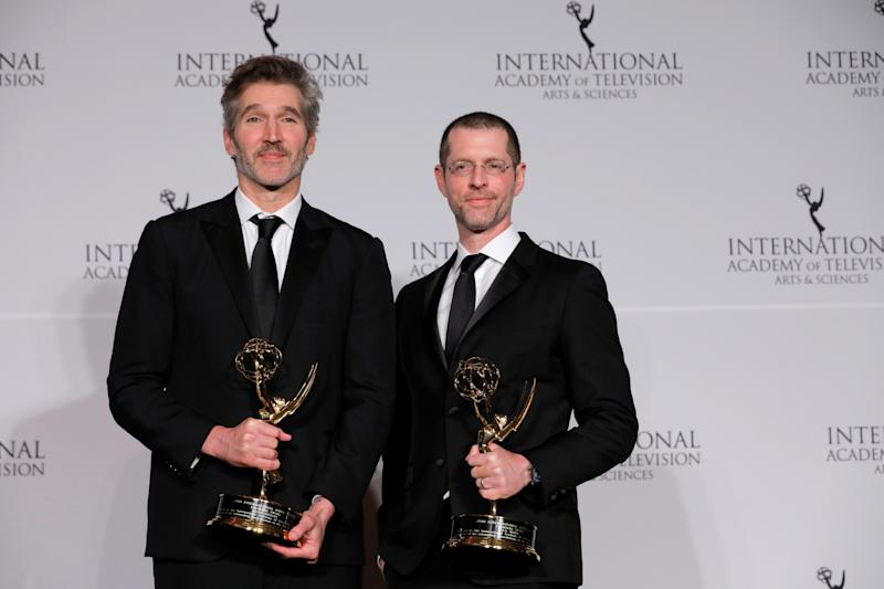 """David Benioff and D.B. Weiss pose with the Founders Award award for """"Games of Thrones"""" at the 47th International Emmy Awards in New York City, U.S., November 25, 2019. REUTERS/Andrew Kelly"""