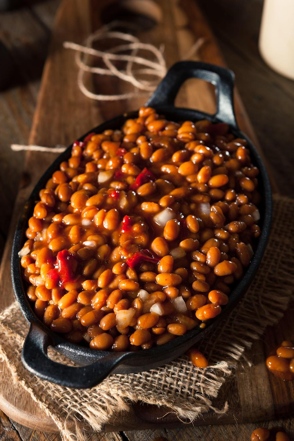 """This is a simple recipe that combines sweet and smoky ingredients for a thick, rich, and perfect barbecue side dish. <a href=""""https://www.epicurious.com/recipes/food/views/classic-bbq-baked-beans?mbid=synd_yahoo_rss"""" rel=""""nofollow noopener"""" target=""""_blank"""" data-ylk=""""slk:See recipe."""" class=""""link rapid-noclick-resp"""">See recipe.</a>"""