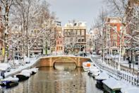 """<a href=""""https://www.cntraveler.com/destinations/amsterdam?mbid=synd_yahoo_rss"""" rel=""""nofollow noopener"""" target=""""_blank"""" data-ylk=""""slk:Amsterdam"""" class=""""link rapid-noclick-resp"""">Amsterdam</a> is magical during the holidays—with Christmas celebrations that last for the entire month of December—but we recommend visiting the Dutch capital during the later winter months as well. While the city is no stranger to <a href=""""https://www.cntraveler.com/story/loving-the-world-to-death-the-good-bad-and-ugly-of-overtourism?mbid=synd_yahoo_rss"""" rel=""""nofollow noopener"""" target=""""_blank"""" data-ylk=""""slk:overtourism"""" class=""""link rapid-noclick-resp"""">overtourism</a>, those infamous crowds noticeably thin out when the temperatures drop, meaning you can enjoy snow-shrouded canal views and cozy restaurants in peace. And we swear—<a href=""""https://www.cntraveler.com/gallery/best-restaurants-in-amsterdam?mbid=synd_yahoo_rss"""" rel=""""nofollow noopener"""" target=""""_blank"""" data-ylk=""""slk:Dutch food"""" class=""""link rapid-noclick-resp"""">Dutch food</a>, hearty with lots of bread and potatoes, is even more satisfying on cold days."""