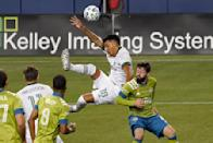 Portland Timbers defender Julio Cascante (18) makes a bicycle kick in front of Seattle Sounders midfielder Joao Paulo, right, during the second half of an MLS soccer match, Sunday, Sept. 6, 2020, in Seattle. (AP Photo/Ted S. Warren)