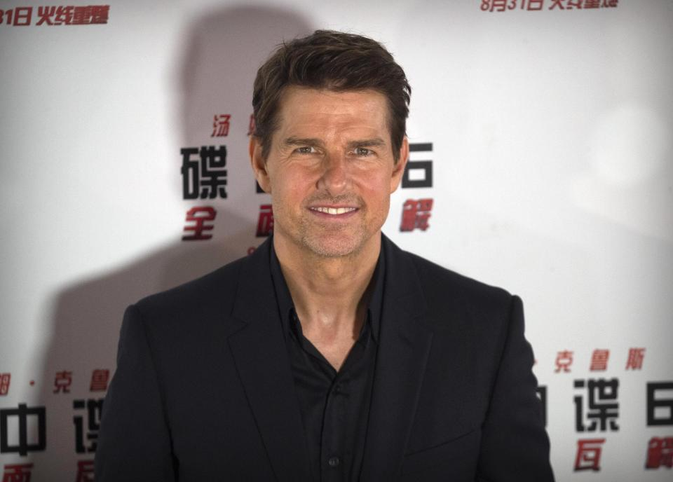 """FILE - In this Aug. 29, 2018 file photo, Tom Cruise poses for photos during a red carpet event for the movie """"Mission: Impossible - Fallout"""" at the Imperial Ancestral Temple in Beijing, China. Before the Wednesday, May 27, 2020 planned launch of two NASA astronauts aboard a SpaceX rocket, NASA administrator Jim Bridenstine, said, """"I will tell you this: NASA has been in talks with Tom Cruise and, of course, his team, and we will do everything we can to make it a successful mission, including opening up the International Space Station,"""" he told The Associated Press. (AP Photo/Mark Schiefelbein)"""