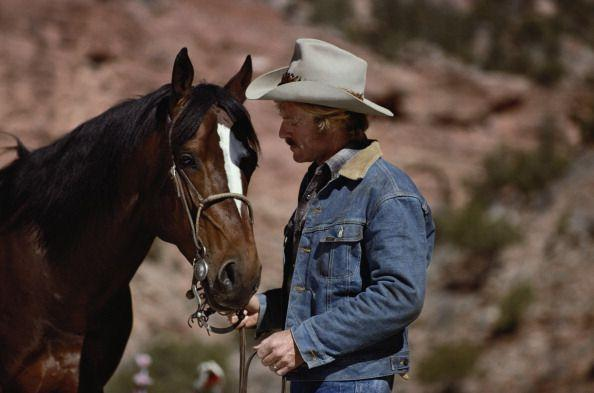 <p>Robert Redford took many cues from the Western actors before him. One of which was embracing the Canadian tuxedo in <em>The Electric Horseman</em>. The mustache and horse are just an added bonus. </p>