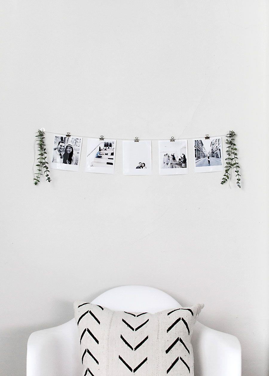 """<p>Create some nostalgic Christmas decor by creating a photo montage of black and white family snapshots from holidays past. </p><p><a href=""""https://www.homeyohmy.com/diy-instant-film-photo-garland/"""" rel=""""nofollow noopener"""" target=""""_blank"""" data-ylk=""""slk:Get the tutorial."""" class=""""link rapid-noclick-resp"""">Get the tutorial.</a></p><p><a class=""""link rapid-noclick-resp"""" href=""""https://www.amazon.com/Metal-Bulldog-Clips-Inches-Black/dp/B0747RLJWD?tag=syn-yahoo-20&ascsubtag=%5Bartid%7C10072.g.37499128%5Bsrc%7Cyahoo-us"""" rel=""""nofollow noopener"""" target=""""_blank"""" data-ylk=""""slk:SHOP CLIPS"""">SHOP CLIPS</a></p>"""