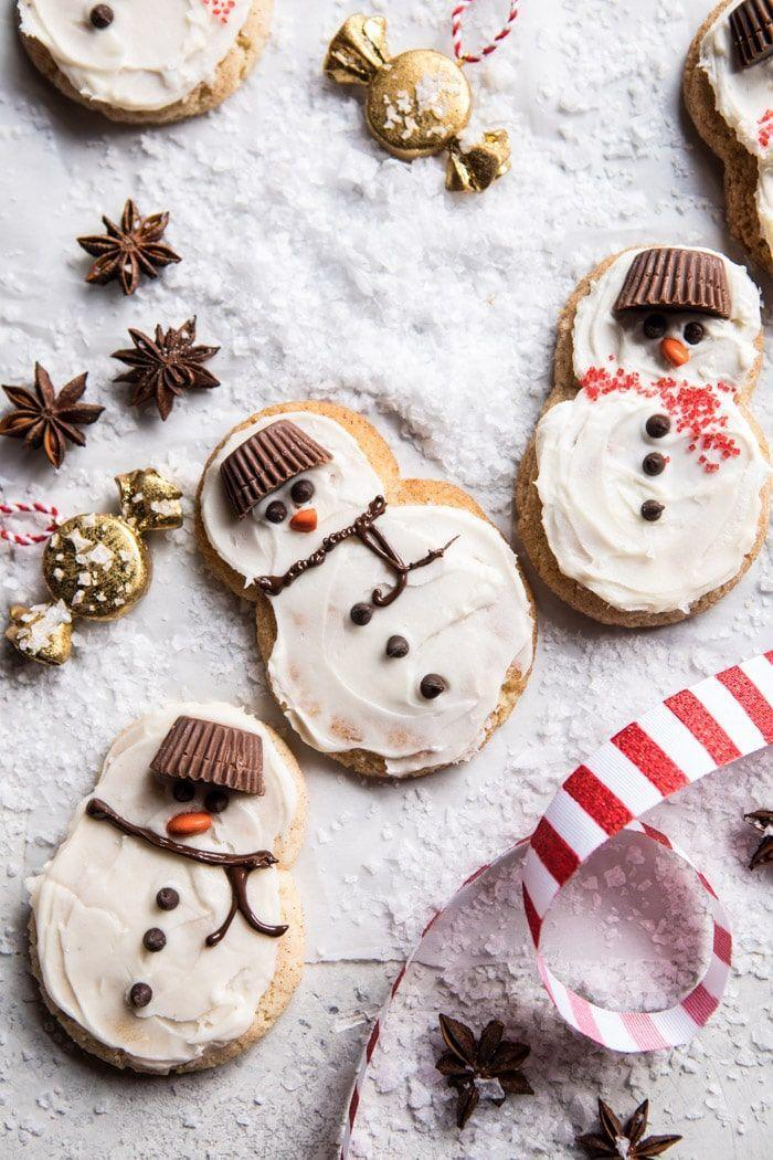 """<p>Your little one will have a blast decorating these snowmen. How cute are those Reese's Peanut Butter Cup hats?</p><p><strong>Get the recipe at <a href=""""https://www.halfbakedharvest.com/eggnog-frosted-chai-snickerdoodle-snowmen/"""" rel=""""nofollow noopener"""" target=""""_blank"""" data-ylk=""""slk:Half Baked Harvest"""" class=""""link rapid-noclick-resp"""">Half Baked Harvest</a>.</strong></p>"""