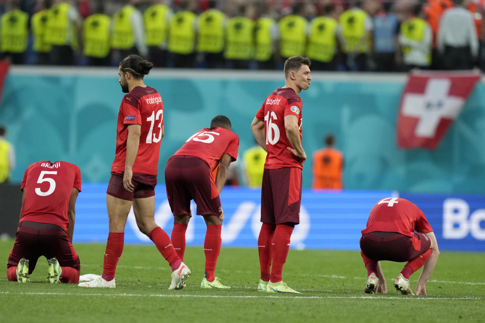 Switzerland players react after Spain won 3-1 a penalty shootout after extra time during the Euro 2020 soccer championship quarterfinal match between Switzerland and Spain at Saint Petersburg stadium in St. Petersburg, Russia, Friday, July 2, 2021. (AP Photo/Dmitri Lovetsky, Pool)