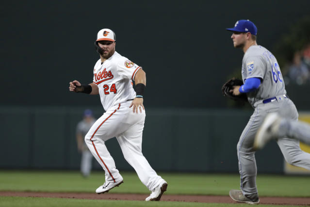 Baltimore Orioles' DJ Stewart (24) gets caught in a pickle as Kansas City Royals first baseman Ryan O'Hearn (66) chases him during the second inning of a baseball game, Wednesday, Aug. 21, 2019, in Baltimore. (AP Photo/Julio Cortez)