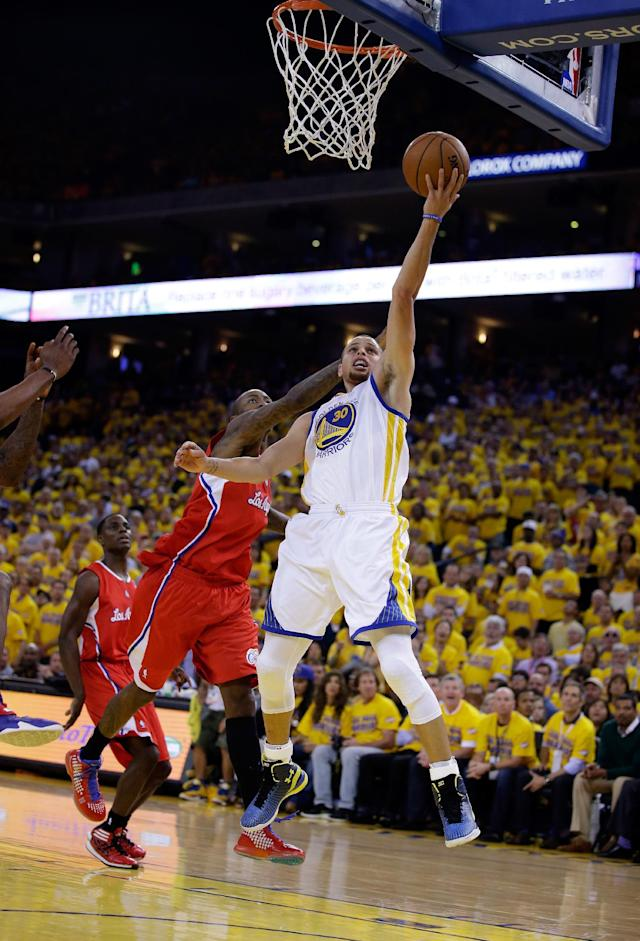 OAKLAND, CA - MAY 01: Stephen Curry #30 of the Golden State Warriors goes up for a shot against the Los Angeles Clippers in Game Six of the Western Conference Quarterfinals during the 2014 NBA Playoffs at ORACLE Arena on May 1, 2014 in Oakland, California. (Photo by Ezra Shaw/Getty Images)