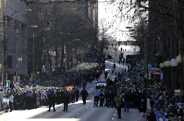 Seattle Seahawks fans line the street during the Super Bowl champions parade on Wednesday, Feb. 5, 2014, in Seattle. The Seahawks beat the Denver Broncos 43-8 in NFL football's Super Bowl XLVIII on Sunday. (AP Photo/Ted S. Warren)