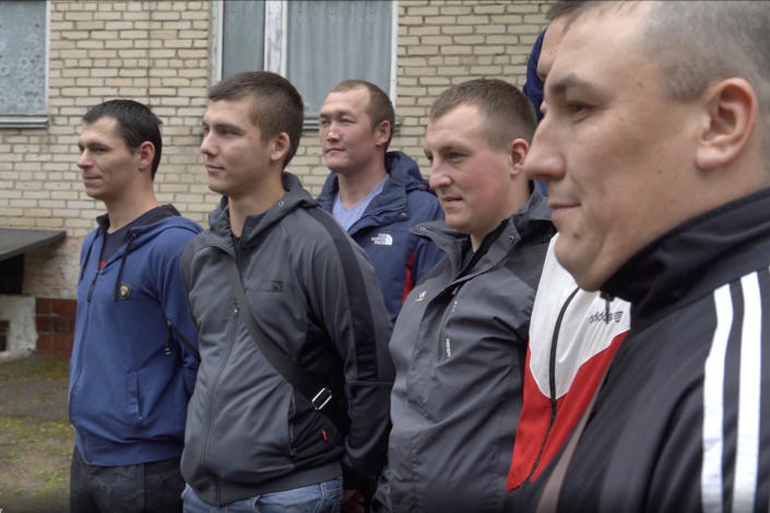 In this photo made from footage provided by the Russian Defense Ministry on Wednesday, July 15, 2020, a group of volunteers participating in a trial of a coronavirus vaccine pose for a photo as they leave the Budenko Main Military Hospital outside Moscow, Russia. Russia is boasting that it's about to be the first country to approve a COVID-19 vaccine, but scientists worldwide are sounding the alarm that the headlong rush could backfire. (Russian Defense Ministry Press Service via AP)