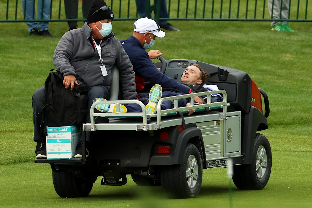 KOHLER, WISCONSIN - SEPTEMBER 23: Tom Felton is carted off the course after collapsing during the celebrity matches ahead of the 43rd Ryder Cup at Whistling Straits on September 23, 2021 in Kohler, Wisconsin. (Photo by Andrew Redington/Getty Images)