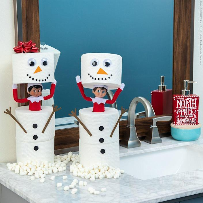 """<p>Help your Scout Elves hide in plain sight with this silly bathroom-based idea. Googly eyes and construction paper make it easy. </p><p><strong>Get the tutorial at <a href=""""https://elfontheshelf.com/elf-ideas/peekaboo/"""" rel=""""nofollow noopener"""" target=""""_blank"""" data-ylk=""""slk:Elf on the Shelf"""" class=""""link rapid-noclick-resp"""">Elf on the Shelf</a>.</strong></p>"""