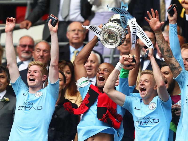 Vincent Kompany of Manchester City lifts the trophy: Getty Images